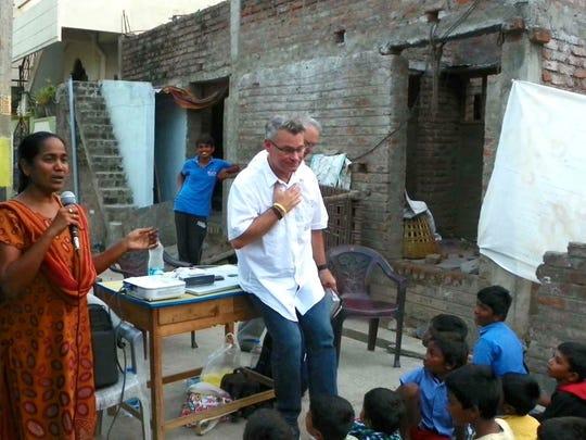 Carl Toth teaches children in India.