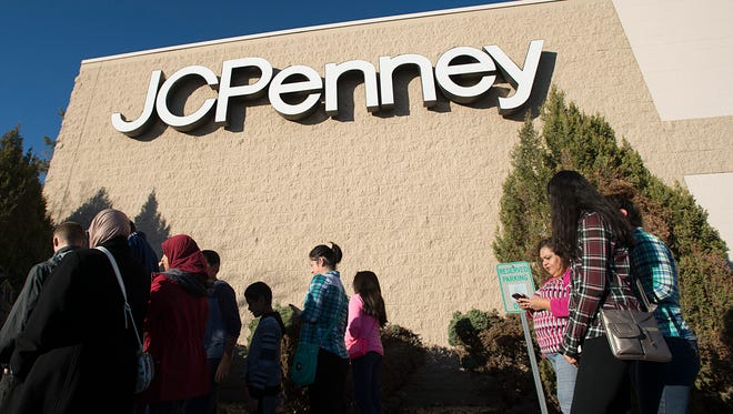 People wait for doors to open at JCPenney on Bockman Drive for Black Friday promotions Thursday, November 24, 2016. A line wrapped around the department store before doors opened at 3 p.m.