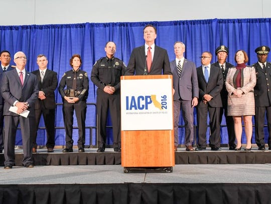 FBI Director James Comey, along with law enforcement