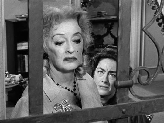 "In ""What Ever Happened to Baby Jane?"" Bette Davis terrorizes her sister (Joan Crawford), a former child star."
