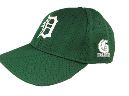 Fans can purchase a green Detroit Tigers baseball hat with a Groves High School logo on April 22 at Comerica Park.