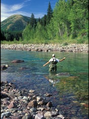 A fly fisherman fishes the Middle Fork of the Flathead
