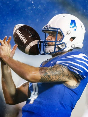 University of Memphis quarterback Riley Ferguson miss handles a pass during warmup before taking the field against the University of Louisiana-Monroe at the Liberty Bowl Memorial Stadium.