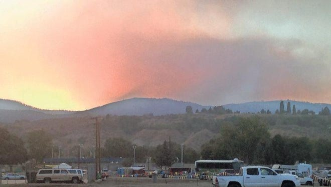 The glow of the deadly Washington state Okanogan fire is evident in the sky in this photo taken in the evening from base camp.