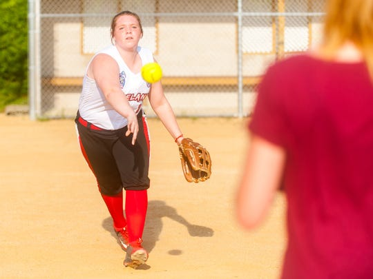 Zoe Frisko flips the ball during a drill while at Vineland Pigtails practice on Wednesday.