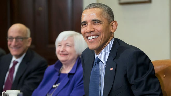 President Obama smiles during his meeting with financial regulators in the Roosevelt Room of the White House in Monday.