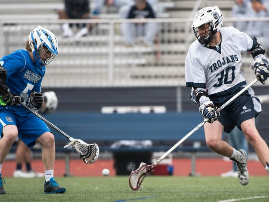 Selisgrove's Gabe Ludwig, left, and Chambersburg's Hunter Leedy go for the ball during a boys lacrosse game Saturday. Selisgrove defeated the Trojans, 16-4.
