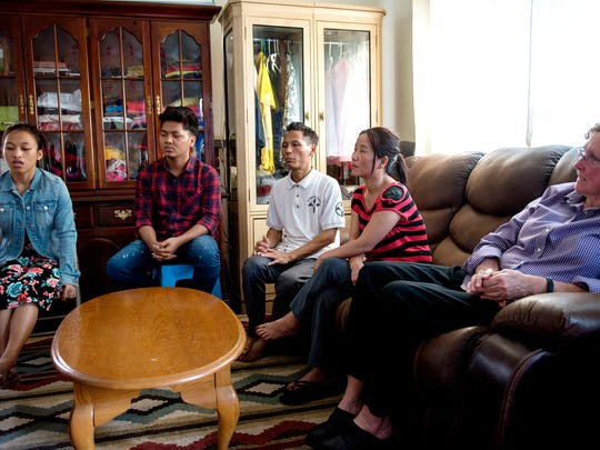 From left, Ning San Mang, Tung Sian Hau, Kam Sian Tung, Man No and Jeanne Meier talk about Tung Sian Hau being reunited with his family at his home on Wednesday, May 16, 2018, in Lansing. Meier found an attorney in San Diego willing to work with the family to help get Tung Sian Hau back with his parents.