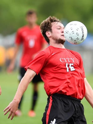 Iowa City's Adam Nicholson (16) stops the ball with his chest as Sioux City West's Daniel Escoto (9) pursues him on Thursday, June 4, 2015, during the Boys State Soccer Tournament held at Cownie Soccer Complex.