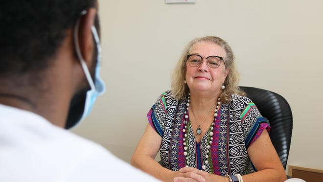 Sue Norcross Proctor works with a man involved in the Men in Transition program at SAFE.