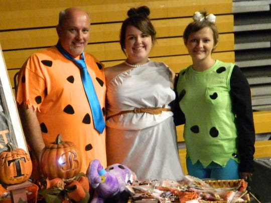 The Flintstones were happy to give away treats at the annual Halloween Festival