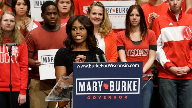 First lady Michelle Obama speaks at a campaign event for Wisconsin Democratic gubernatorial candidate Mary Burke on Tuesday in Madison, Wis. Mrs. Obama rallied young voters in Wisconsin's race for governor, saying if they show up to vote Republican Gov. Scott Walker can be defeated.