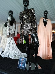 """Dresses by Palm Springs' own Michael Costello, who also starred on """"Project Runway,"""" were displayed on Wednesday. In the foreground is a dress Costello designed for singer Beyonce."""