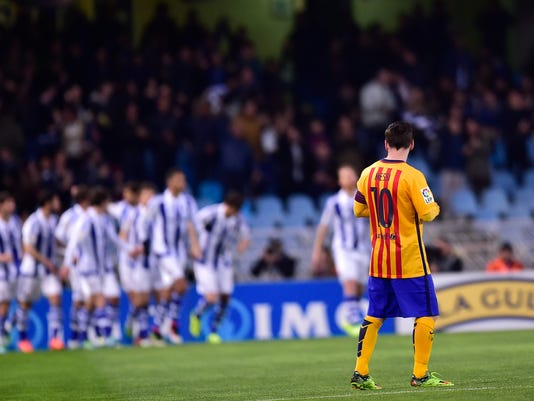 Barcelona's Lionel Messi of Argentina, looks across at Real Sociedad's players after their goal during their Spanish La Liga soccer match between Barcelona and Real Sociedad, at Anoeta stadium in San Sebastian, northern Spain, Saturday, April 9, 2016. (AP Photo/Alvaro Barrientos)