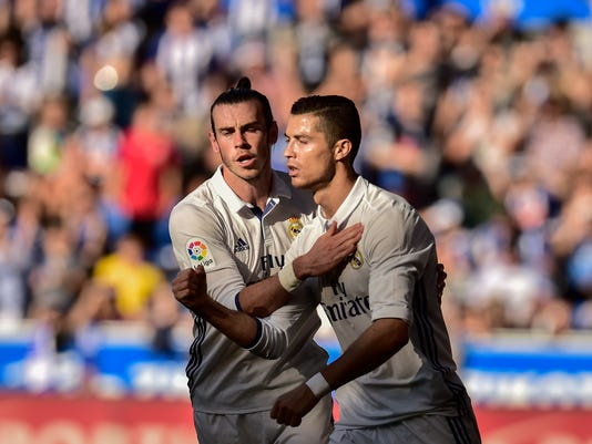 Real Madrid's Cristiano Ronaldo, right, celebrates his goal with Gareth Bale, during the Spanish La Liga soccer match between Real Madrid and Deportivo Alaves, at Mendizorroza stadium, in Vitoria, northern Spain, Saturday, Oct. 29, 2016. (AP Photo/Alvaro Barrientos)