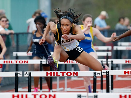Greece Athena's Destiny Fernandes won the 100 hurdles with a time of 15.50 seconds during the Runnin' Cadet Classic at Hilton High School.