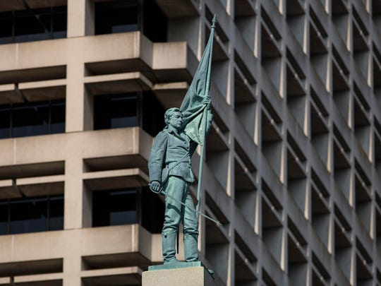 The city of Norfolk, Va., is fighting to remove this 15-foot figure of a Confederate soldier from its downtown.