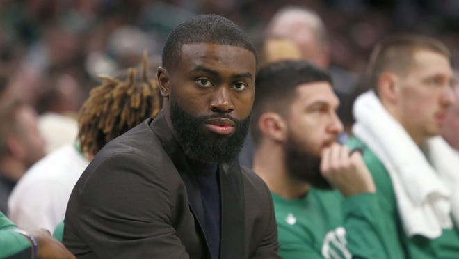 Celtics guard Jaylen Brown looks on from the bench earlier this season. In May, in the wake of George Floyd's death, Brown drove from Boston to Atlanta to participate in protests decrying acts of racial injustice by law enforcement.