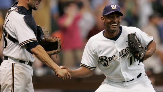 Brewers closer Salomon Torres celebrates his save with Jason Kendall after the 7-3 win over the Baltimore Orioles at Miller Park Sunday afternoon.   Brewers win 7-3 over the Orioles