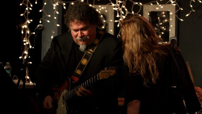 Bill Lloyd (left) and singer Jonell Mosser lock into a groove at the 17th annual Freedom Sings concert at a jam-packed The Bluebird Cafe.