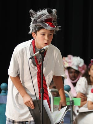 """Denver Brown performs in """"The Trial of the Big Bad Wolf"""" in July at Clinton Elementary School in Columbus, Ohio. It was part of a five-week summer reading program to help failing third-graders improve their skills so they can move on to fourth grade."""