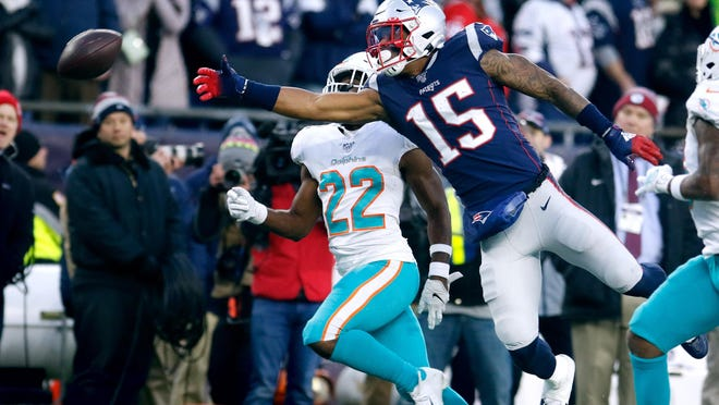 Patriots receiver N'Keal Harry leaps for a Hail Mary pass with 2 seconds left as the Patriots lose to the Dolphins at Gillette Stadium.