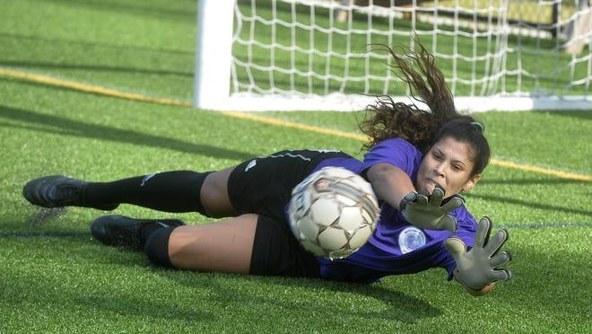 Sydney Martinez stops a goal during a Savannah Spirit practice Tuesday.