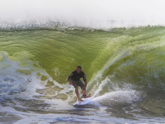 Brian Dalton of Belmar enjoys some morning surfing. Surfers take advantage of the bigger waves caused by the passing of Cristobal off the coast to do some early morning surfing in Belmar NJ on August 28, 2014. Peter Ackerman / Staff Photographer.