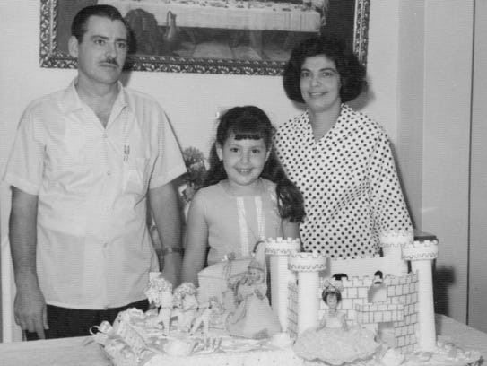Maria Harper-Marinick (center) with her parents, Frank