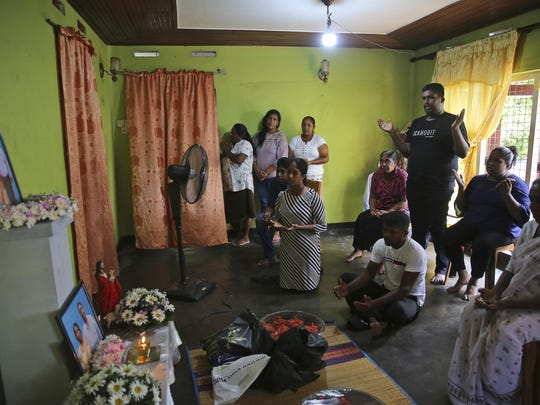 Relatives of Sri Lankan couple Rohan Marselas Wimanna and Mary Noman Shanthi, who were killed in Easter Sunday bomb blasts pray at their residence on the seventh day of mourning in Negombo, north of Colombo, Sri Lanka, Sunday, April 28, 2019.