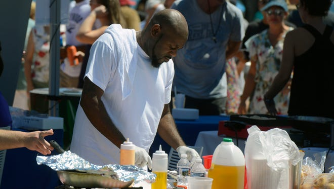 Vendors serve up food Saturday, Sept. 16, 2017, during Taste of the Beach at Pensacola Beach.