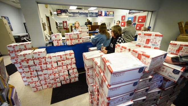 Volunteers prepare 250 care packages for mailing to troops serving overseas Wednesday, Nov. 30, at the Waite Park Post Office. The effort is organized by Becky Carlson. This is the 14th year she and volunteers have prepared a special holiday package for troops.