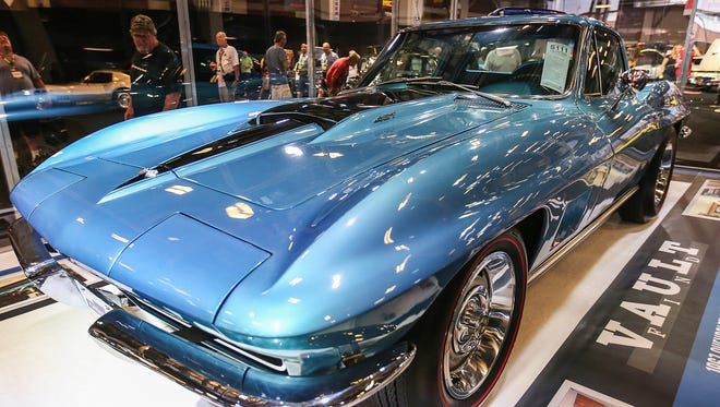 """A marina blue 1967 Chevrolet Corvette that will be auctioned off Saturday at the 30th annual Mecum Auctions, Indiana State Fairgrounds, Indianapolis, seen on Friday, May 19, 2017. The Corvette belonged to late Vietnam war hero Richard Litavsky, who kept the vehicle in impeccable shape and largely out of public view, making it the closest you'll come to a """"vault find"""" at this year's auction."""
