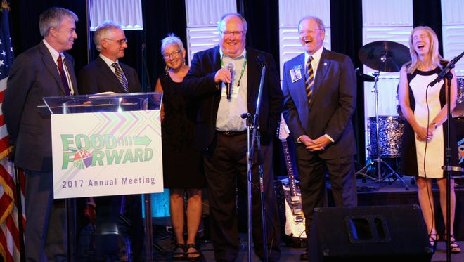 Scott Rawlins receives the Lea S. Hitchner Service Award at CropLife America's Annual Meeting on Sept. 26 in Dana Point, CA. Pictured (left to right) is John Thacher (Wilbur-Ellis President and CEO), Dan Vradenburg (Wilbur-Ellis Company President), Barbara Rawlins (Scott's wife), Scott Rawlins (Wilbur-Ellis Company Director, Regulatory and Government Affairs), Jay Vroom (CLA President and CEO) and Diane Allemang (FMC Corporation, outgoing CLA chairperson).