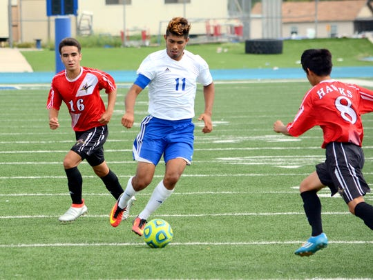 Carlsbad's David Soto moves the ball down the field