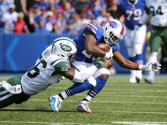 Bills running back LeSean McCoy is tackled by Jets Demario Davis.