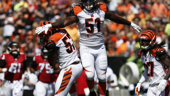 Cincinnati Bengals middle linebacker Vincent Rey (57) and linebacker Jayson DiManche (51) celebrate after a play in the first half at Paul Brown Stadium.