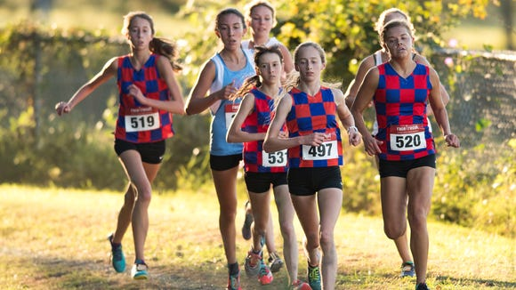 From left, in checkerboard shirts, Riverside's Laura MacGregor, Katherine Rogers, Jessie Crowley and Carter Marchbanks (along with J.L. Mann's Morgan Moseley and Greer Middle College's Morgan Summey) compete during the Greenville County meet Oct. 18 at Woodmont High School.