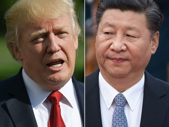 President Donald Trump (l) and Chinese President Xi