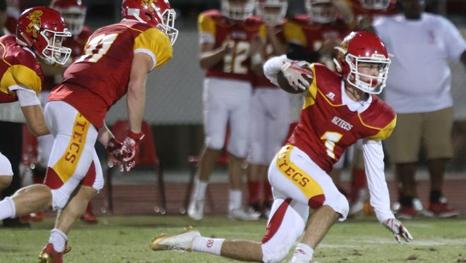 Palm Desert's Jacob McIlroy carries the ball after and interception against Xavier Prep in the second quarter on Friday, September 22, 2017 at Palm Desert High School.
