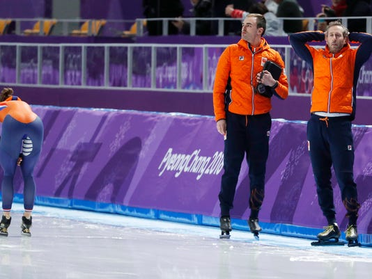 Dutch coach Rutger Tijssen, right, grabs his head after Ireen Wust, left, of The Netherlands, left, finished a fraction of a second behind her compatriot Carlijn Achtereekte in the women's 3,000 meters race at the Gangneung Oval at the 2018 Winter Olympics in Gangneung, South Korea, Saturday, Feb. 10, 2018. (AP Photo/John Locher)