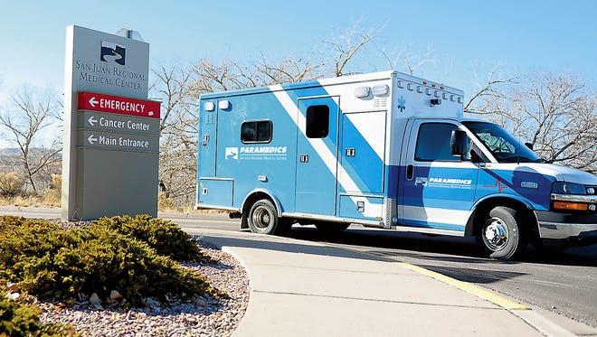 A San Juan County Regional Medical Center Emergency ambulance drives by on Monday, Dec. 23, 2013, on West Maple Street, in Farmington.