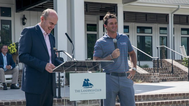 Steven Freund, left, executive director of The Landings Club, and pro golfer Sam Saunders were on hand for the ribbon-cutting ceremony Tuesday at the new Marshwood Clubhouse.