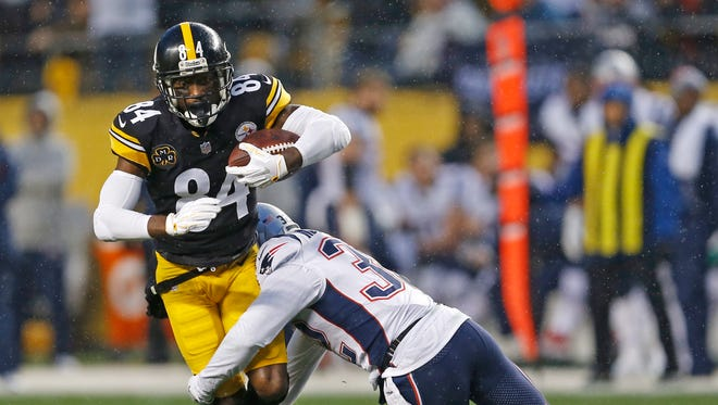 Pittsburgh Steelers wide receiver Antonio Brown (84) is tackled by New England Patriots free safety Devin McCourty (32) during the first half of an NFL football game in Pittsburgh, Sunday, Dec. 17, 2017.