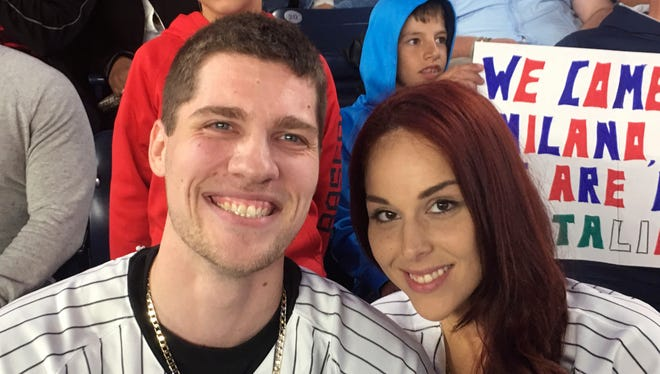 Andrew Fox, left, and Heather Terwilliger sit in the stands at Yankee Stadium on Tuesday night, Sept. 27, 2016, in New York. When Fox pulled the ring from his pocket and dropped to one knee before Terwilliger to propose during the fifth inning of the Yankees' game, the ring dropped to the ground. A frantic search ensued. After about five minutes, Terwilliger looked down and saw something shiny in the cuff of her pants leg.