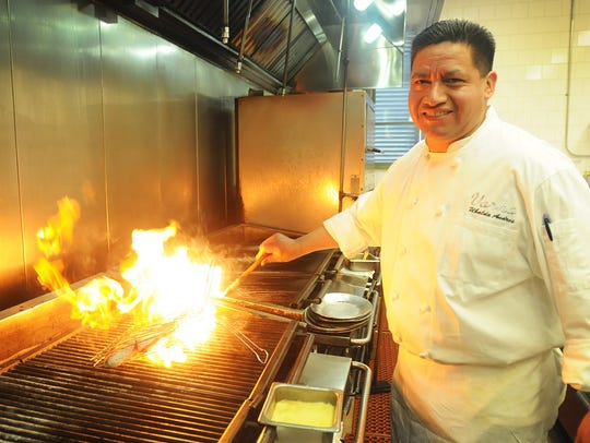 Photo of chef Ubaldo Andres working in the kitchen