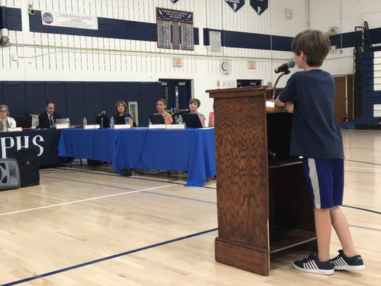 Peter Caminiti, one of the fifth graders on the Paramus school bus crash, addresses the local school board on Mon., June 18, 2018.
