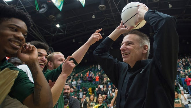 CSU basketball coach Larry Eustachy celebrates with the Rams following his 500th career win in an 85-58 victory over Air Force at Moby Arena on Saturday, January 7, 2017.