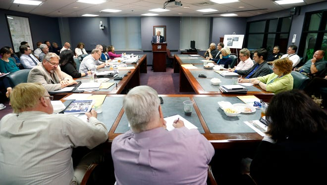 Greene County Presiding Commissioner Bob Cirtin presents a plan to the Springfield City Council to build a temporary jail facility during council lunch on Tuesday, May 24, 2016.