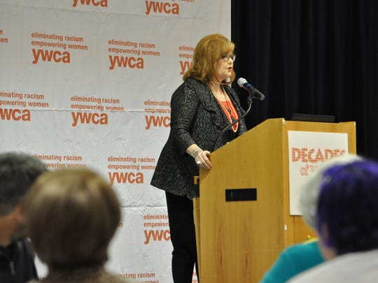 Deborah Randolph, Central Louisiana Chamber of Commerce president, accepts a Distinguished Woman of the Year award during the YWCA of Alexandria-Pineville Decades of Women luncheon on Thursday.